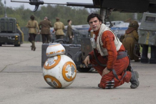"BB-8 and Poe Dameron (Oscar Isaac) reunite on the tarmac in this scene from ""Star Wars: The Force Awakens"" (Photo Credit: Disney/Lucasfilm)"